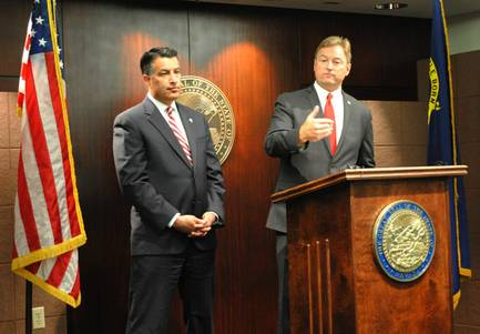 U.S. Sen. Dean Heller, R-Nev., and Nevada Gov. Brian Sandoval, left, conduct a joint news conference to discuss cuts to Medicaid proposed under a GOP health care law that would replace Obamacare.