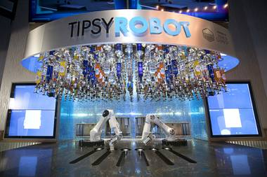 A view of robotic bartenders in the Tipsy Robot automated bar in the Miracle Mile Shops at Planet Hollywood Monday, June 26, 2017. The bar is scheduled to open on Friday.