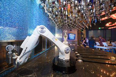 Robotic bartenders prepare drinks in the Tipsy Robot automated bar in the Miracle Mile Shops at Planet Hollywood Monday, June 26, 2017. The bar is scheduled to open on Friday.