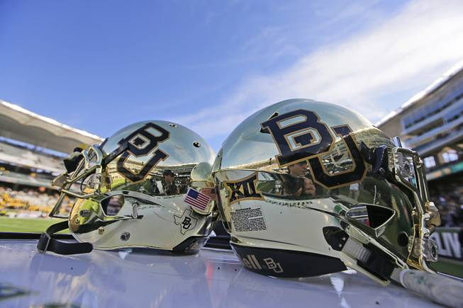 In this Dec. 5, 2015, file photo, Baylor helmets on shown the field after an NCAA college football game in Waco, Texas.