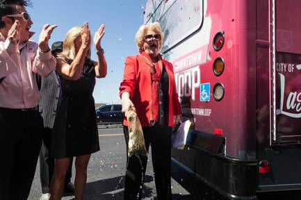 Mayor Carolyn G. Goodman christened a shuttle during a media event for the Downtown Loop, a free shuttle service in Downtown Las Vegas, Nev. on June 27, 2017. The Downtown Loop is a six-month pilot program that is a partnership between the city of Las Vegas, the RTC of Southern Nevada and Keolis Transit..