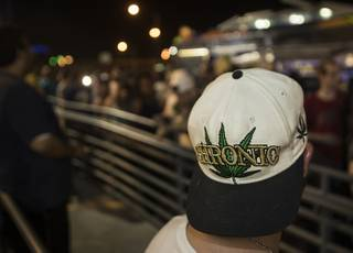 Many customers waiting in a long line at Reef Dispensaries wear weed-related items as recreational sales of marijuana begin at Midnight in Nevada and dispensaries across Las Vegas are open too on Friday, June 30, 2017.
