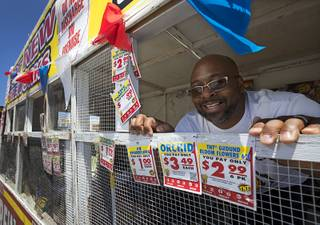 Bonanza High School football coach Dion Lee looks out from a fundraising fireworks booth at the Terrible Herbst at Buffalo Drive and Lake Mead Boulevard Monday July 3, 2017. The firework sales are part of Lee's efforts to raise $100,000 for the football program, he said.