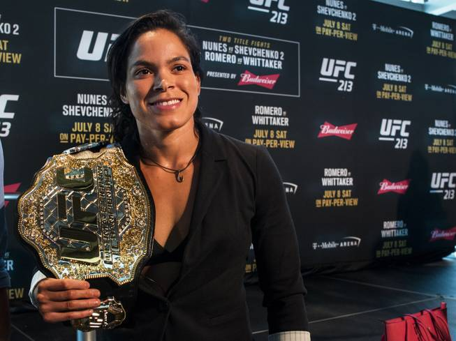 UFC213 women's bantamweight champion Amanda Nunes holds her belt as fighters meet with the media at the T-Mobile Arena on Thursday, July 6, 2017.
