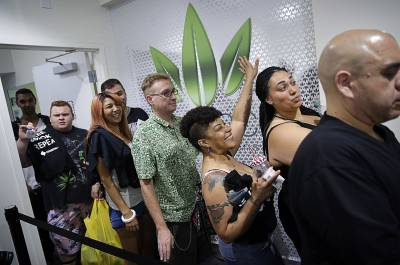 People wait in line at the Essence cannabis dispensary in Las Vegas, Saturday, July 1, 2017, as recreational sales of marijuana begin.