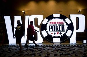 People pass by a WSOP sign in a hallway during day 2c of the World Series of Poker Main Event at the Rio Wednesday, July 12, 2017.