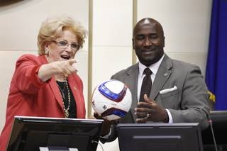 Las Vegas Mayor Carolyn Goodman and Councilman Ricki Barlow joke with a soccer ball during a meeting of the Las Vegas City Council Wednesday, July 19, 2017.