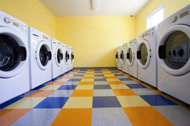 The laundry facilities are seen during the grand opening ceremony of the new Shannon West Homeless Youth Center, Friday, July 14, 2017.