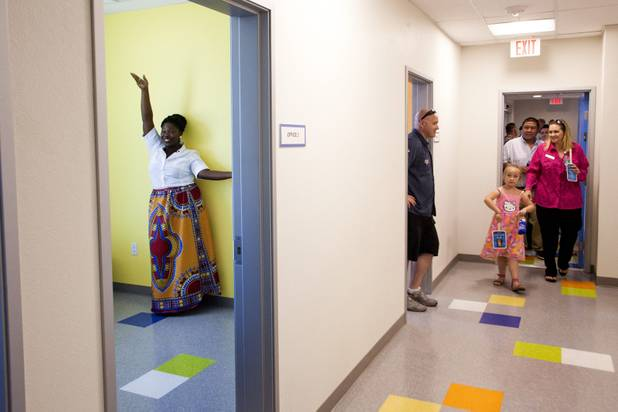Manager of Shannon West Homeless Youth Center MeShayla Ennis poses for a photo inside her new office as people tour the new Shannon West Youth Center during the grand opening ceremony at its new location, Friday, July 14, 2017.