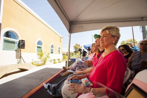 Susan West, front, smiles as her husband Tom West talks about their daughter Shannon West during the grand opening ceremony of the new Shannon West Homeless Youth Center, Friday, July 14, 2017.