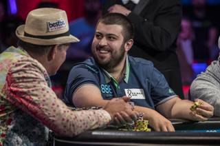Scott Blumstein smiles at his fans after winning a pot during the second of three straight nights to finish poker's world championship as the table goes from 7 to 3 players at the Rio on Friday, July 21, 2017.