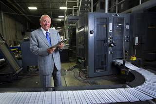Allan Creel Sr., chairman and CEO of Creel Printing poses by a printing press at the company, 6330 W Sunset Rd., Wednesday, Aug. 2, 2017.