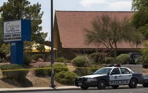 Metro Police officers investigate an officer involved shooting at the Life Springs Christian Church on East Warm Springs Road and Burnham Avenue on Saturday, August 5, 2017.