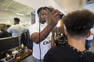 Stylist Will Lacy gives a haircut during a Back to School Party for foster children sponsored by Square Salon and the CASA Foundation Sunday, Aug. 6, 2017. The sixth annual event was expected to serve about 500 children, a spokeswoman said.