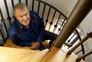 In this July 27, 2011 photo, musician Glen Campbell poses for a portrait in Malibu, Calif. Campbell, the grinning, high-pitched entertainer who had such hits as
