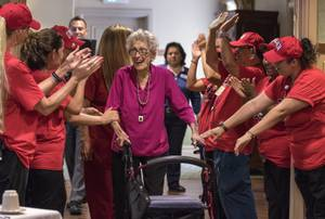 One of UNLV basketball's most dedicated fans, Helen Kottum, receives a special 100th birthday surprise celebration from staffers, UNLV mascot Lil' Reb, administration, family and friends in her home within Las Ventanas at Summerlin on Tuesday, August 8, 2017.