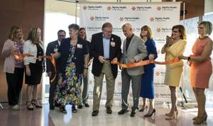 Guests and dignitaries cut a ribbon following the Dignity Health - St. Rose Dominican West Flamingo Campus tour and ribbon cutting ceremony on Thursday, August 10, 2017.