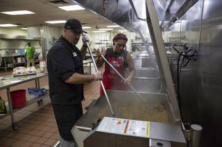 Executive Chef Jeremy Woods prepares for the lunch-time meal, one of 4 meals the Salvation Army prepares for the public at their downtown Las Vegas Dining Facility, Monday, July 31, 2017.