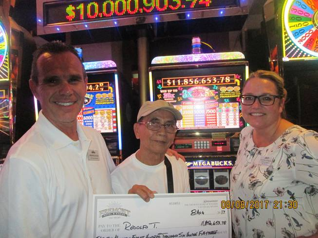 Las Vegas visitor Rodolfo T. hit a $11.8 million Nevada Megabucks jackpot on Aug. 8, 2017, at the Fremont Hotel and Casino. From left are Jim Sullivan, Fremont's vice president and general manager; Rodolfo T.; and Salinda Conklin, Fremont's slot director.