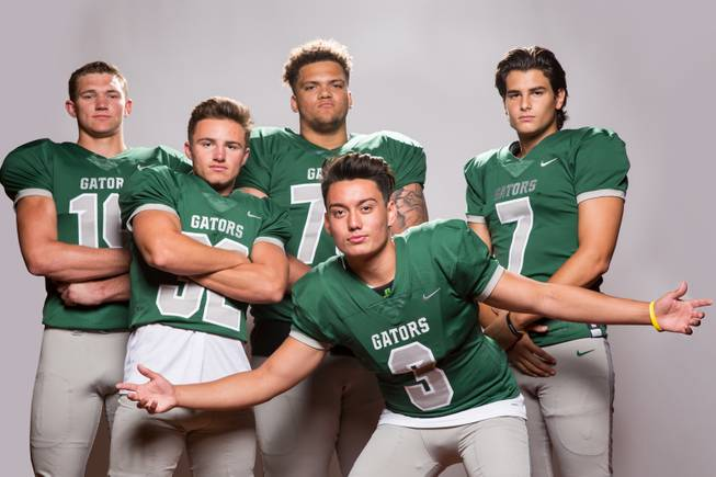Members of the Green Valley High School football team, from left, Chas Kopp, Braxton Harms, Eric Brown, Christian Mayberry, and AJ Barilla pose for a portrait at the Las Vegas Sun's high school football media day August 2, 2017, at the South Point.