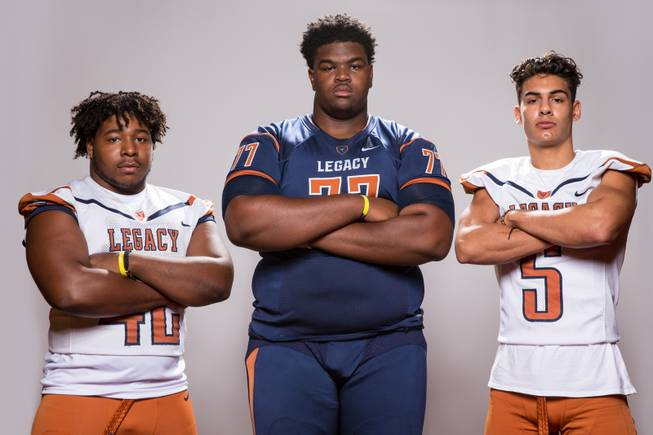 Members of the Legacy High School football team, from left, Amere Foster, Terrence Smith and Roberto Valenzuela pose for a portrait at the Las Vegas Sun's high school football media day August 2, 2017, at the South Point.