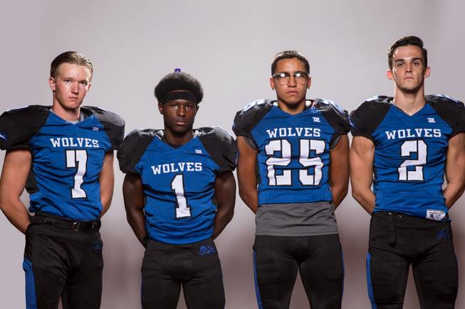 Members of the Basic High School football team, from left, Cole Matoon, Cristian Scales, Jordan Gallegos and Zach Grismanouskas pose for a portrait at the Las Vegas Sun's high school football media day August 2, 2017, at the South Point.