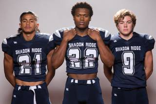 Members of the Shadow Ridge High School football team, from left, Kaejin Smith, Aubrey Nellems and Chase Harlaher pose for a portrait at the Las Vegas Sun's high school football media day August 2, 2017, at the South Point.
