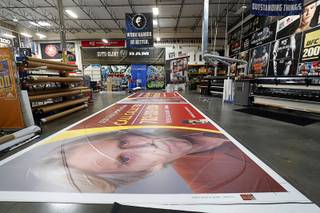 A billboard wrap is shown on the shop floor at Screaming Images Wednesday, Aug. 16, 2017. The company is a graphic design, print and installation business.