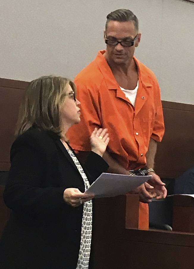 Nevada death row inmate Scott Raymond Dozier confers with Lori Teicher, a federal public defender involved in his case, during a Thursday, Aug. 17, 2017, appearance in Clark County District Court in Las Vegas.