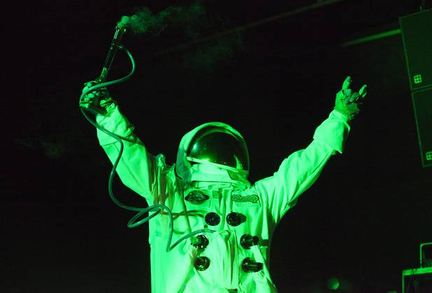 An astonaut mascot for Sleep smokes from a bong during their set at the Psycho Festival at the Hard Rock Hotel and Casino Friday, Aug. 18, 2017.