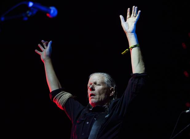 Swans frontman Michael Gira raises his arms as he conducts the band during their set at  the Psycho Festival at the Hard Rock Hotel and Casino, Sunday, Aug 20, 2017.