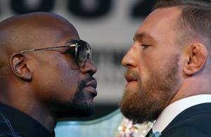 Undefeated boxer Floyd Mayweather Jr. and UFC lightweight champion Conor McGregor of Ireland face off during a news conference at the MGM Grand Wednesday, Aug. 23, 2017.