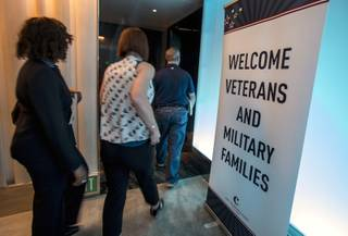 Attendees arrive at a penthouse gathering as the Cosmopolitan hosts another Supporting Our Veterans Career Fair on Wednesday, August 23, 2017.