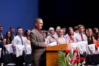 Shawn Gerstenberger, Ph.D., Acting Dean, UNLV School of Medicine, speaks to students, family and friends during the school's charter class White Coat Ceremony at Artemus Ham Mall, Friday Aug. 25, 2017.