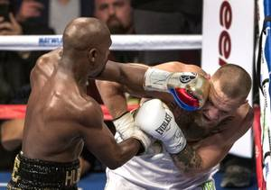 Super welterweight Floyd Mayweather Jr. drives a punch to the temple of Conor McGregor during their fight at the T-Mobile Arena on Saturday, August 26, 2017.