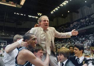 In this March 24, 1985, file photo, Villanova coach Rollie Massimino takes a victory ride on his players' shoulders. Massimino, who led Villanova's storied run to the 1985 NCAA championship and won more than 800 games in his career, died Wednesday, Aug. 30, 2017, after a long battle with cancer. He was 82. (AP Photo/File)