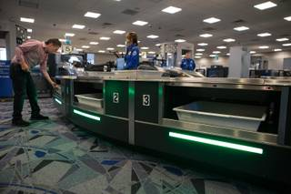 Travelers use new automated screening lanes at the security checkpoint in Terminal 3 at McCarran International Airport in Las Vegas, Nev. on August 31, 2017.