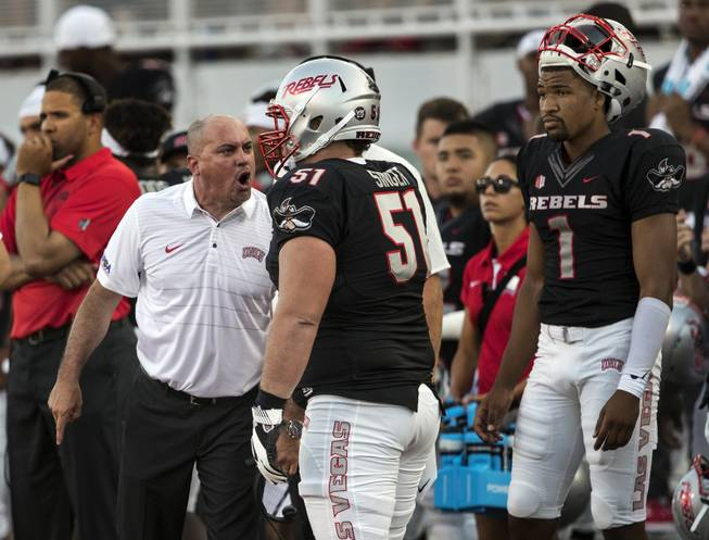 UNLV head coach Tony Sanchez yells at UNLV's Zack Singer (51) during their home-opening football game against Howard on Saturday, September 2, 2017.
