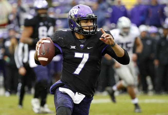 TCU quarterback Kenny Hill (7) looks to pass during the second half of an NCAA college football game against Kansas State, Saturday, Dec. 3, 2016, in Fort Worth, Texas. Kansas State won 30-6.