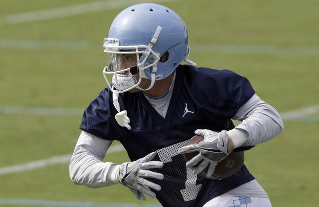 North Carolina wide receiver Austin Proehl runs the ball during the team's first NCAA college football practice of the season in Chapel Hill, N.C., Wednesday, Aug. 2, 2017.