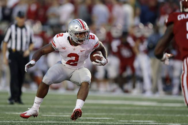 Ohio State's J.K. Dobbins in action during the first half of an NCAA college football game against Indiana, Thursday, Aug. 31, 2017, in Bloomington, Ind.