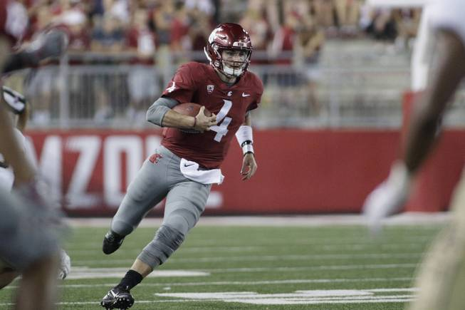 Washington State quarterback Luke Falk (4) runs with the ball during the second half of an NCAA college football game against Montana State in Pullman, Wash., Saturday, Sept. 2, 2017.