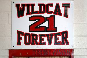A sign over a locker room door pays tribute to #21 Eddie Gomez at Las Vegas High School Thursday, Sept. 7, 2017. Gomez, a player with the Las Vegas High School football team, died in 2003, two days after suffering a head injury in a playoff game.