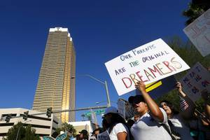 DACA recipients and supporters rally near the Trump International Hotel in Las Vegas Sunday, Sept. 10, 2017.