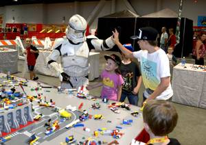 A Galactic Empire Stormtrooper helps put together rockets, space ships and other-worldly vehicles in the Space Station area of Brick Fest Live Lego Fan Experience at the Las Vegas Convention Center, September 9, 2017.