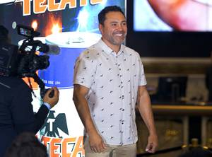 Oscar De La Hoya, chairman/CEO of Golden Boy Promotions, smiles ...