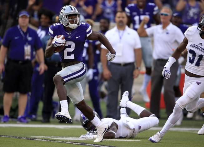 Kansas State return specialist D.J. Reed (2) dodges a tackle by Central Arkansas' Lester Wells (17) for a 96-yard kickoff return during the first half of an NCAA college football game in Manhattan, Kan., Saturday, Sept. 2, 2017. Reed was finally tackled on the four-yard-line.