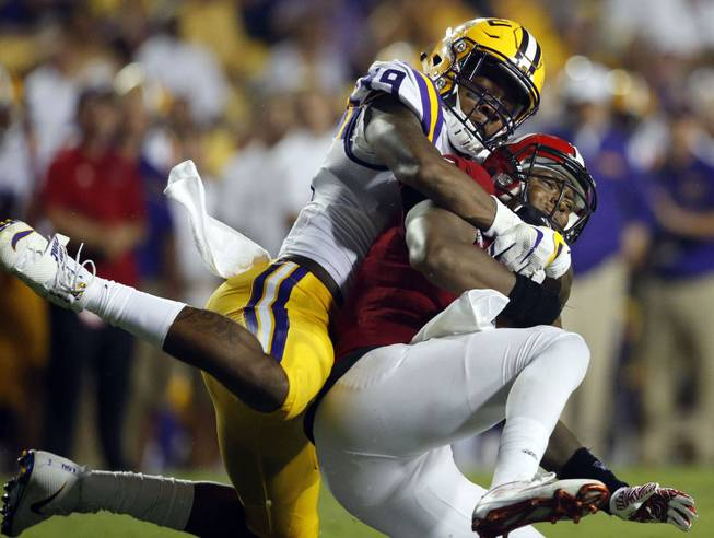 In this Sept. 10, 2016, file photo, Jacksonville State quarterback Eli Jenkins is sacked by LSU defensive end Arden Key (49) in the second half of an NCAA college football game in Baton Rouge, La. Key has been cleared to come back from shoulder surgery and play Saturday, Sept. 16, 2017 at Mississippi State.