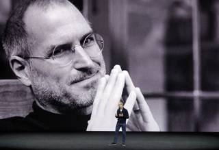 With a photo of former Apple co-founder and CEO Steve Jobs projected in the background, Apple CEO Tim Cook kicks off the event for a new product announcement at the Steve Jobs Theater on the new Apple campus, Tuesday, Sept. 12, 2017, in Cupertino, Calif.