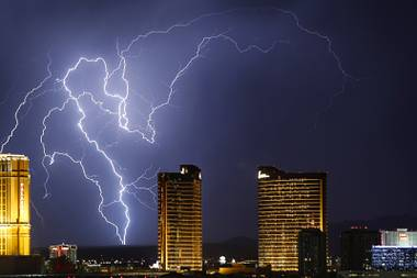 Lightning strikes behind Las Vegas Strip casinos as a thunderstorm passes through the northwest valley Wednesday, Sept. 13, 2017.